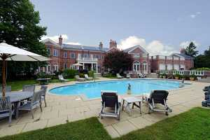 The grounds of the estate feature several colorful gardens, an in-ground swimming pool, a large patio and a pool house. The auctioneer said a 157-foot dock with 11 boat slips is also available for the high bidder of Penderyn to purchase on the adjacent lot.