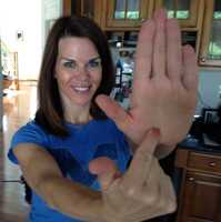 Megan's from Ann Arbor, Mich. She demonstrates the Michigan mitt shape with her hand.