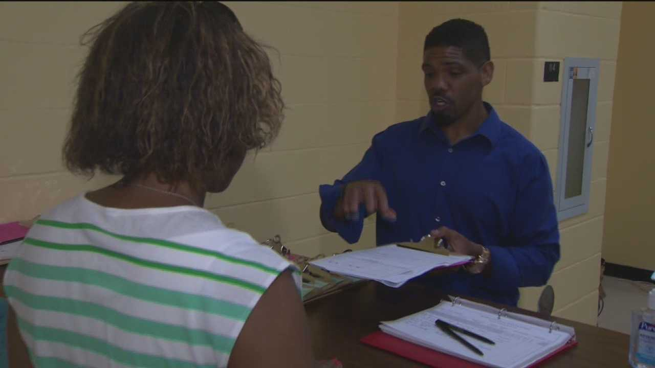 School registration office moves to accommodate crowd