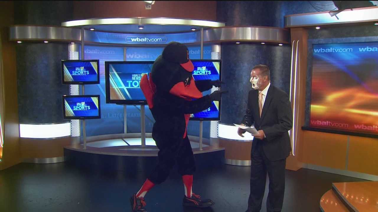 Keith Mills pied by Oriole Bird on 11 News set