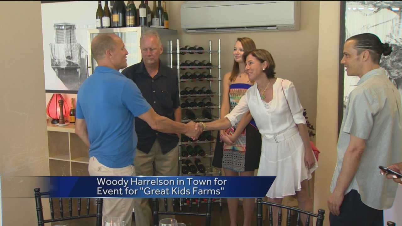 Woody Harrelson greets patrons at The Inn at the Black Olive during a charity event for Great Kids Farm.
