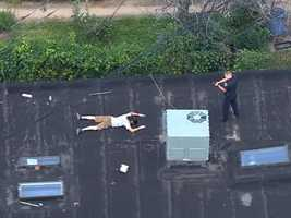 SkyTeam 11 on Thursday captured video as Baltimore City police arrested a person on a roof in the Highlandtown neighborhood of southeast Baltimore.
