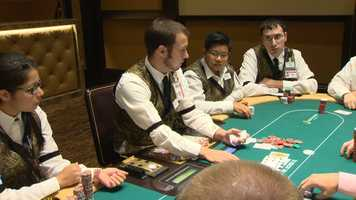 "Poker dealers practiced on the tables Friday. Officials say customer service will be a big focus at the casino. ""I think that's what makes or breaks a room. They can play poker anywhere, poker is poker. You won't eat at a place that has bad service right?"" said poker room supervisor Victor Leone."