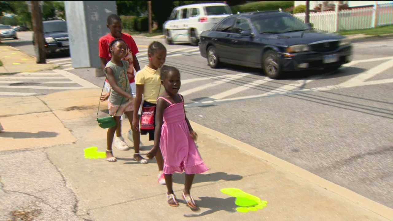 Safe routes to school marked with green footprints