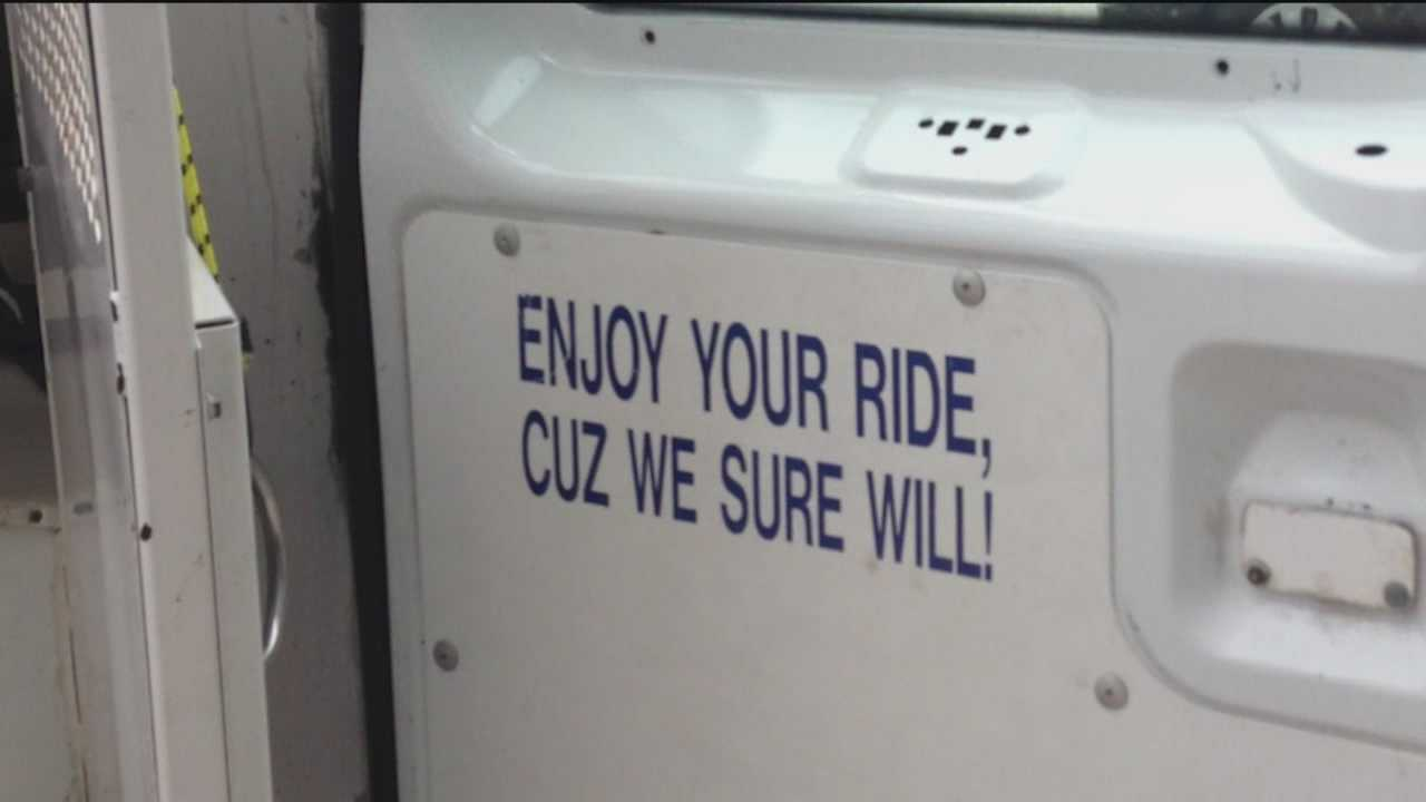 """The Baltimore City Police Department has launched an internal investigation after a WBAL-TV 11 News viewer shared four photographs of a sign inside a city police wagon that says """"Enjoy your ride, cuz we sure will!"""""""