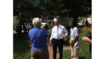 Rep. Elijah Cummings speaks with Ellicott City residentsevacuated during July 30, 2016 flood.