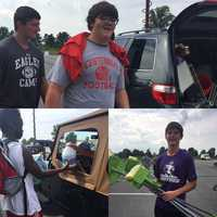 Howard County high school football players collecting food donations for victims of the Ellicott City flooding.