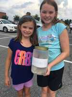 Grace and Sophia Nanni donate money from their lemonade stand -- $320 -- to help the victims of the flooding.