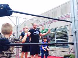 MCW wrestler Joe Keys steps into the steel cage with kids for a demonstration during the MCW Tribute to the Legends convention.