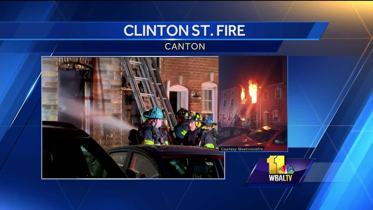 A 60-year-old woman jumped from a second-floor window Thursday during a fire that spread to multiple row homes on the 1200 block of Clinton Street.