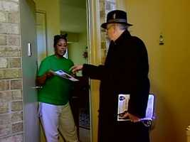 Police detectives and volunteers go door to door to spread the word of Phylicia's disappearance.
