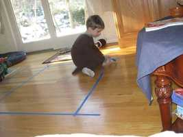 Finn using his painters tape