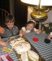 Finn and Charlotte decorating bunny cake at Easter.