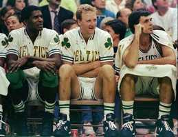 Robert Parish, Larry Bird, and Kevin McHale watch their team win over the Washington Bullets on Nov. 30, 1991.