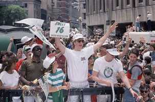 Larry Bird rides the parade truck through the streets of Boston, June 10, 1986 during the celebration of the team's 16th NBA Championship.
