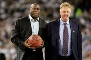 Larry Bird and Magic Johnson walk on the court to be honored for the 30th anniversary of their match up in 1979 NCAA Championship Game.
