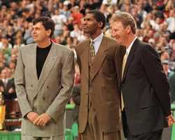 Robert Parish stands with former teammates Kevin McHale and Larry Bird during Parish's number retirement ceremony in Boston, Jan 18, 1998.