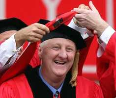 Larry Bird bends down to receive an honorary degree during Boston University's graduation ceremony, May 17, 2009.