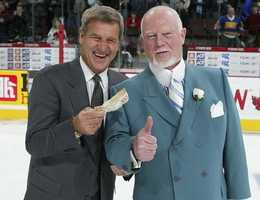 Bobby Orr smiles and holds up the $100 he won from head coach Don Cherry after Orr's team won the CHL Top Prospects game 7-2 on Jan. 18, 2006