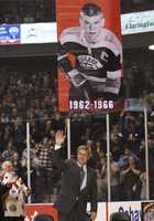 Bobby Orr waves to fans as his banner heads to the rafters as his number was retired by his Ontario Hockey League junior team, the Oshawa Generals on  Nov. 27, 2008.