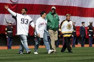 Sports champions (L-R) Richard Seymour, Tedy Bruschi, Bill Russell, and Bobby Orr walk to the mound to make a ceremonial first pitch on April 11, 2005 at Fenway Park.