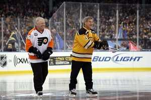 Honorary captains Bobby Clarke, of the Philadelphia Flyers, and Bobby Orr meet at center ice before the Winter Classic at Fenway Park on Jan. 1, 2010.