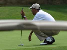 Barack Obama plays golf at the the Mink Meadows Golf Course in Vineyard Haven