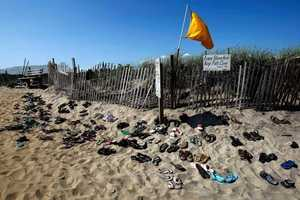 Shoes are left at the entrance to Lucy Vincent Beach in Chilmark.