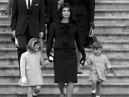 Jacqueline Kennedy walks down the Capitol steps with her daughter Caroline and son John Jr. after President John. F. Kennedy's casket was placed in the rotunda in Washington Nov. 24, 1963.