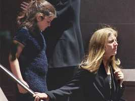 Caroline Kennedy Schlossberg and her daughter, Tatiana, leave the Church of St. Thomas More in New York City July 23, 1999 after a memorial Mass for her brother John F. Kennedy Jr.