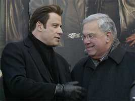 "Actor John Travolta talks with Menino during an event for Travolta's new movie, ""Wild Hogs,"" in Boston, Feb. 7, 2007"