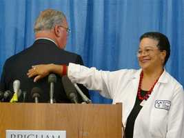 Menino turns his back to cameras as Dr. JudyAnn Bigby indicates the location of an inch-wide tumor removed from his back, July 18, 2003.