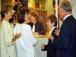 Hillary and Julie Goodridge laugh with attorney Mary Bonato and Menino after the Goodridges' became the first same-sex couple to receive an application for a marriage license in Boston, May 17, 2004.