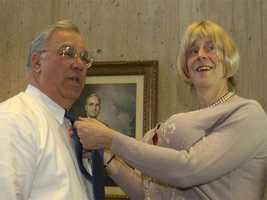 Aerosmith Bassist Tom Hamilton, dressed as Martha Stewart, fixes Menino's tie as part of a publicity campaign, March 25, 2003.