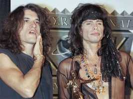 Joe Perry, left, and Steven Tyler, right, of the hard-driving rock band Aerosmith, were honored at the International Rock Awards in New York on Wednesday, June 7, 1990. Aerosmith was named Artist of the Year.
