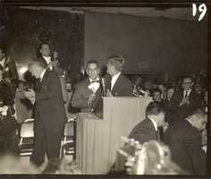 As he took to the stage, President Kennedy acknowledges the Mariachi band.