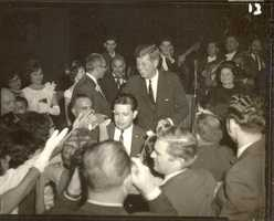 "Shouts of ""Viva Kennedy"" arose in the grand ballroom as the President greeted many in the crowd."
