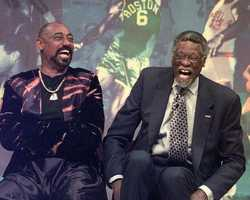 Former NBA rivals Bill Russell and Wilt Chamberlain of the Philadelphia 76ers laugh as they recall their glory days during a tribute to Russell in Boston, May 26, 1999.