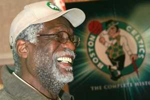 Boston Celtics legend Bill Russell speaks to a reporter in 2004. Russell led the Celtics to 11 NBA championships in 13 seasons.