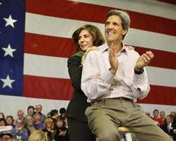 Kerry claps with his wife, Teresa Heinz Kerry, during a presidential campaign rally in Nashua, N.H. Jan. 25, 2004.