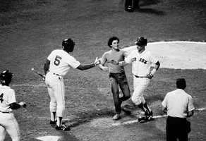 Yastrzemski is congratulated by teammate Bob Watson and an unidentified fan July 24, 1979 after he hit his 400th homer against the Oakland Athletics.