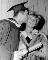 Yaz kisses his wife Carol after receiving a Degree in Business Administration at Merrimack College in Andover, Mass., June 2, 1966.