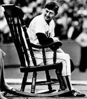 Yaz looks back towards his family as he sits in a rocking chair during retirement ceremonies for him at Fenway Park on Oct. 1, 1983.
