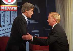 Kerry shakes hands with then Gov. William Weld prior to their second debate June 3, 1996. Weld was challenging Kerry for his Senate seat.