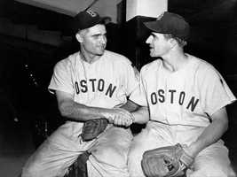 Bobby Doerr, left, Boston Red Sox second baseman, is congratulated by shortstop Johnny Pesky at Yankee Stadium July 1, 1951. Doerr got the 2,000th hit of his major league career.
