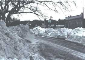 Even once roads re-opened, snow banks were treacherous hazards for drivers.