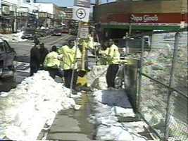 Prison inmates help clear snow.