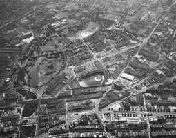 In this 1950 aerial view, Kenmore Square can be seen in the lower-center of the image. Fenway is in the center.