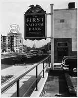 This 1957 shot shows the First National Bank and the Cities Service billboard. The John Hancock Building can be seen on the horizon in the distance.