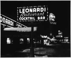 Signs for Leonardi Restaurant and White Fuel light up Kenmore Square in the 1950s.